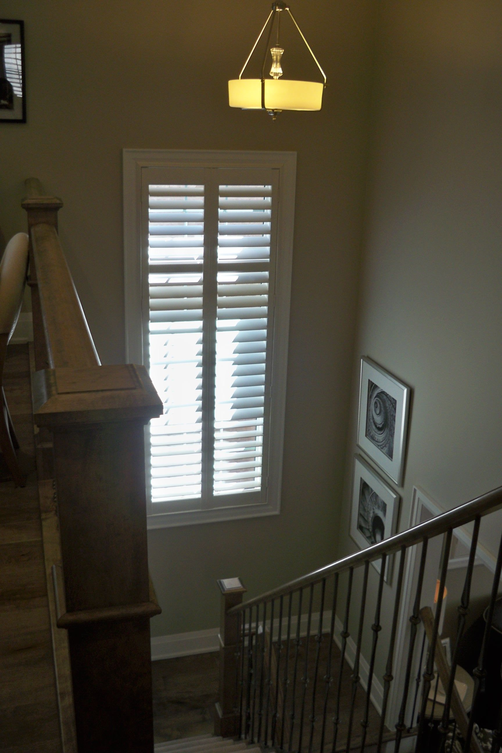 Tall Window In Stairwell With Classic White Custom Window