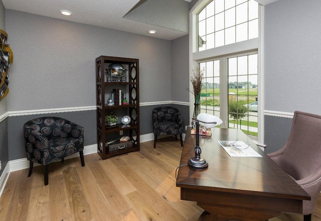 Traditional Home Office With Hardwood Floors Chair Rail High Ceiling Skyline Custom Upholstered Tub Chair Traditional Home Offices Home Home Office Design