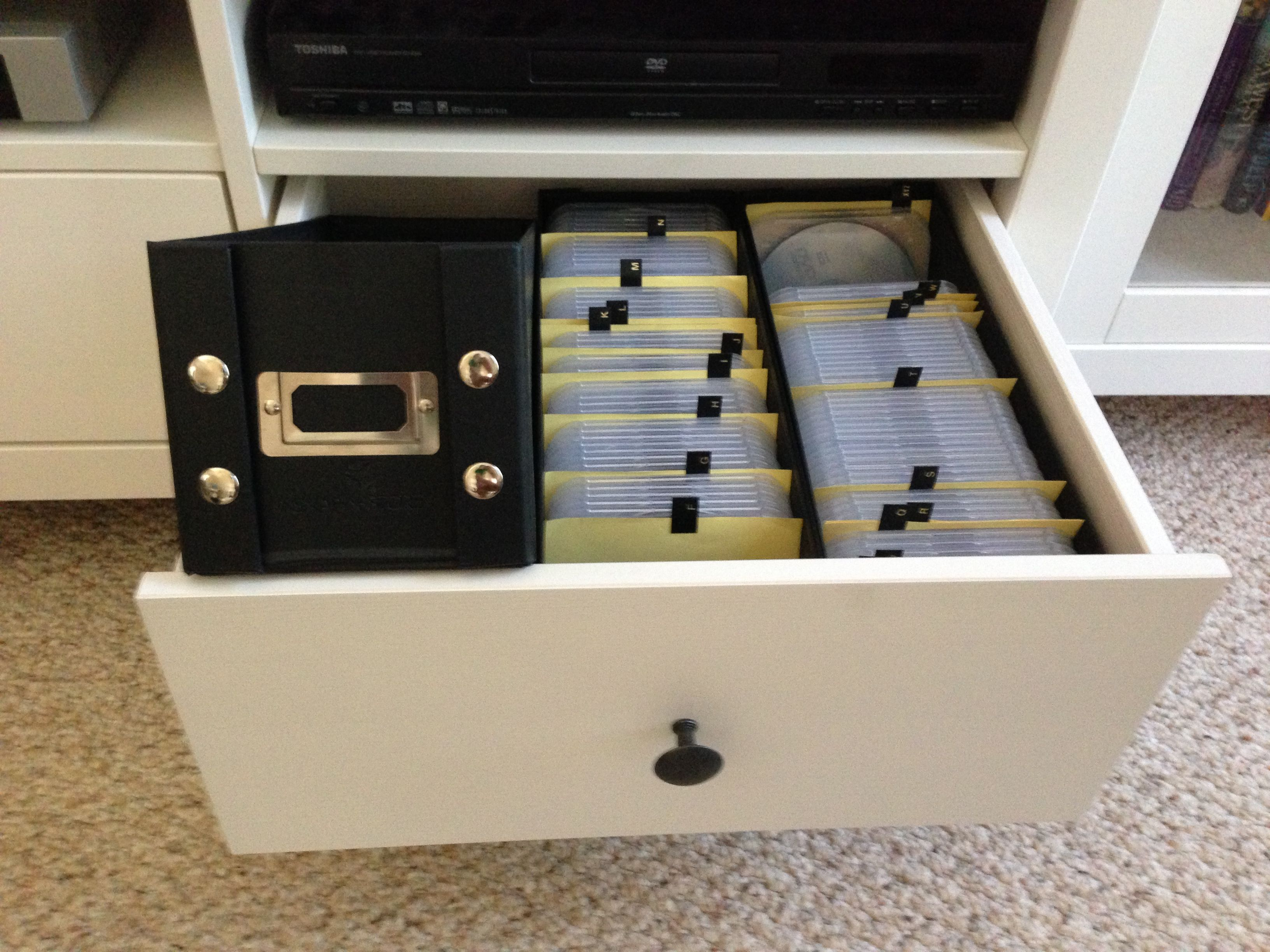 snap and store cd storage boxes on amazon 3 fit perfectly in ikea entertainment center drawers. Black Bedroom Furniture Sets. Home Design Ideas