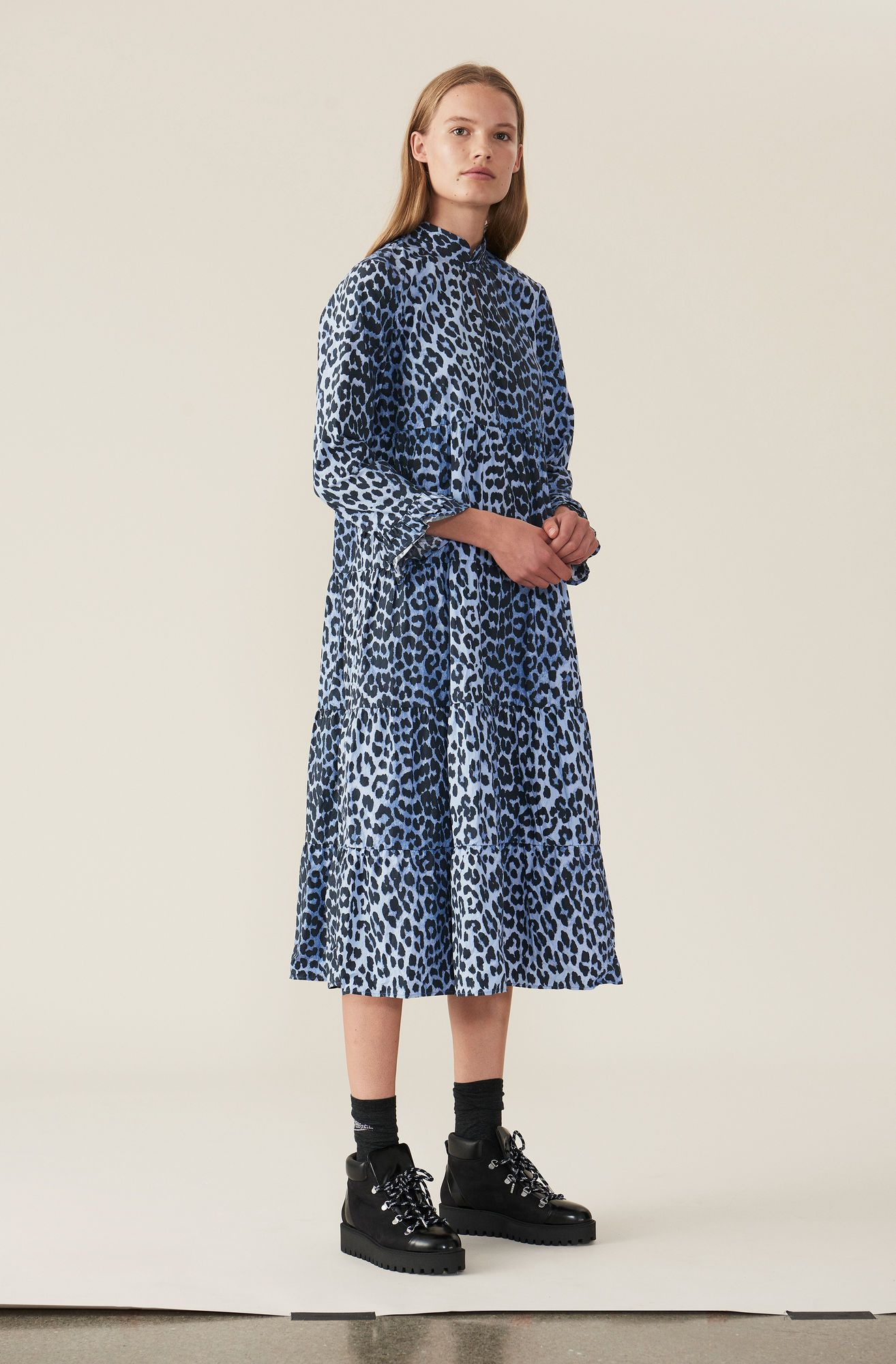 cf83899c Blue leopard print turtleneck maxi dress with ruffle trim sleeves and  tiered peplum hem. This