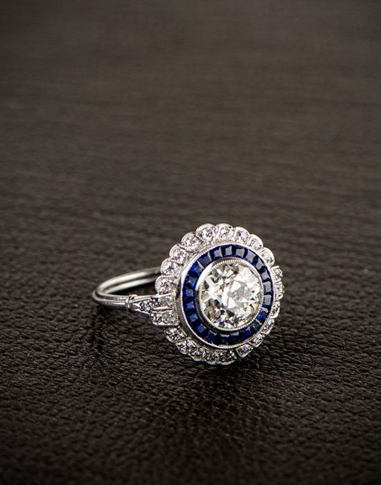 A stunning blue sapphire and diamond engagement ring from @edjewelry