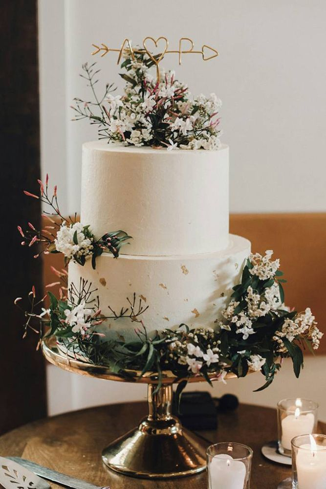 Three round wedding cakes on different leveled stands
