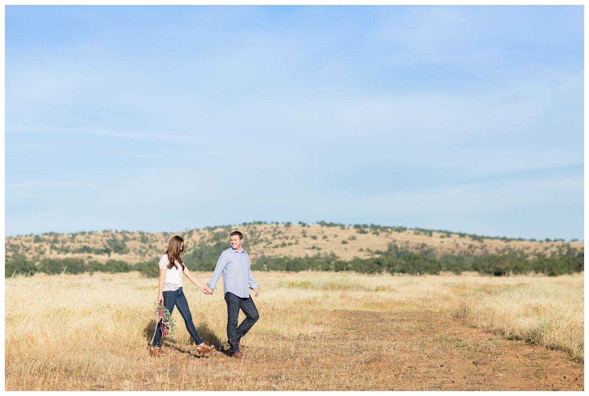 Engagement Portrait Holding Hands | Couple walking together in Bidwell Park Chico California