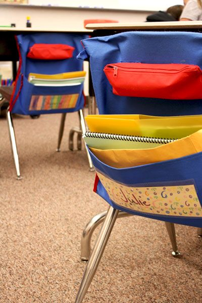 Instead of keeping materials inside the desks where items are often lost, the students keep their supplies in easy-to-access organizers that hang on the back of their chairs.