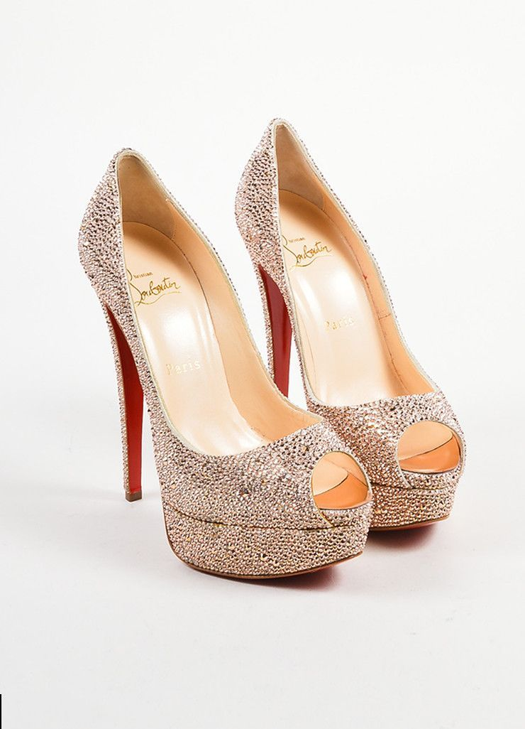 3e77ff4503a4 These dazzling pumps are embellished with shimmering champagne pink  crystals. Front platform and peep toe. Sky high heels add another dramatic  touch.