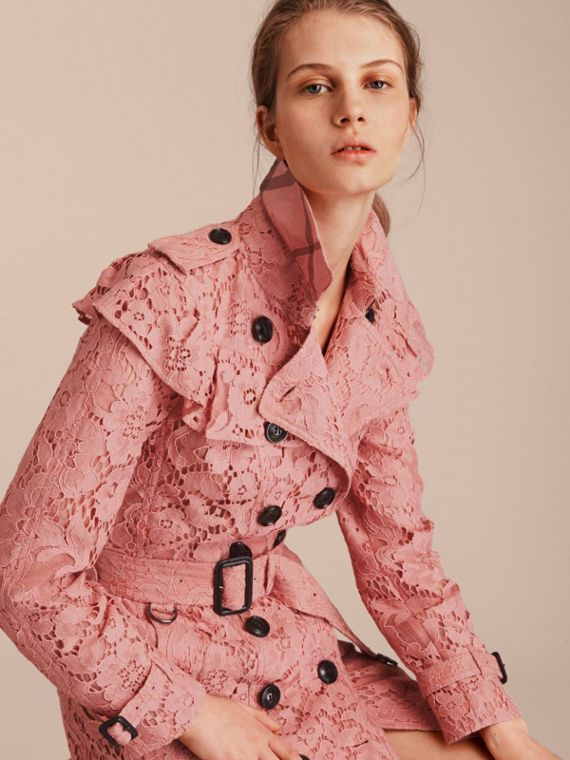 A Burberry trench coat reimagined in Italian macramé lace with ruffle detailing. Cut in a slim fit, the design is crafted with heritage epaulettes, a check undercollar and a D-ring belt. Layer it over everything, from daytime tailoring to evening dresses.