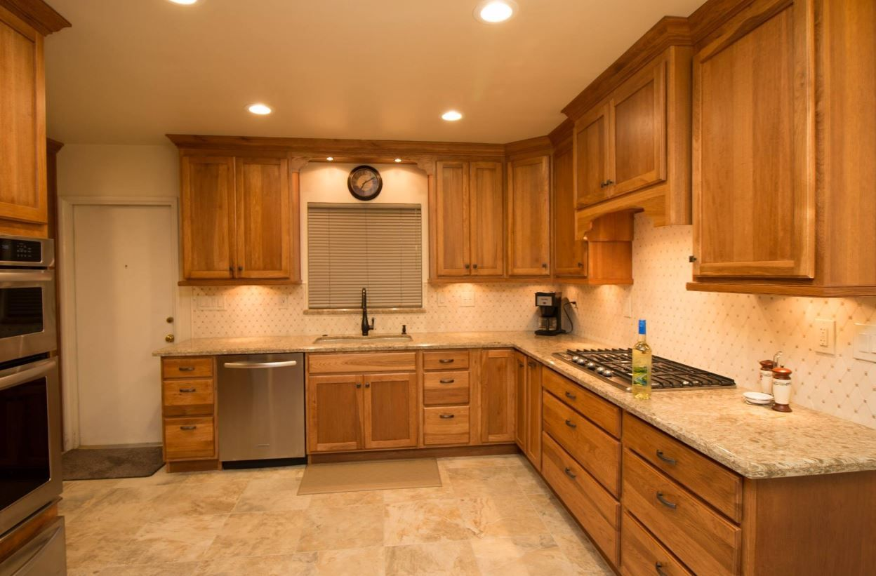 Starmark Hickory Toffee With Cambria Berkely Quartz With Bevel Edge Kitchenaid Stainless Steel Appliances Hickory Kitchen Hickory Kitchen Cabinets Kitchen