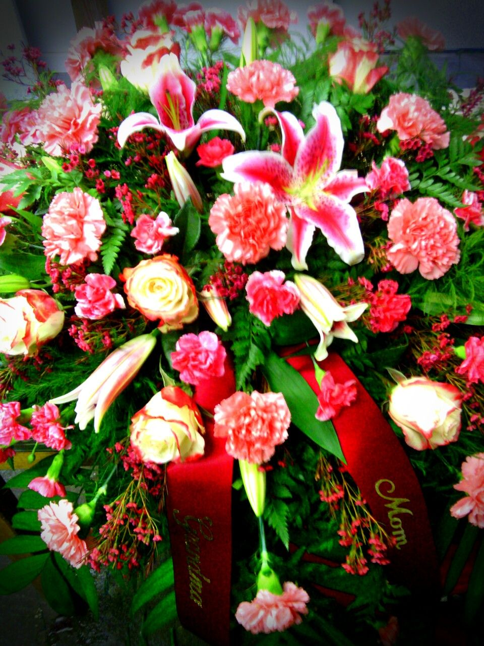 Casket Spray of Fire and Ice roses, Stargazer lilies