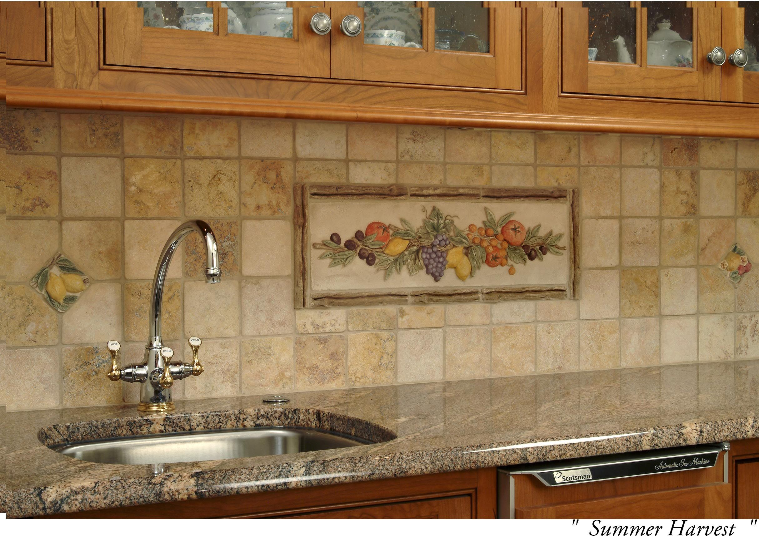 This ceramic tile backsplash uses a Tuscan theme and helps create a ...