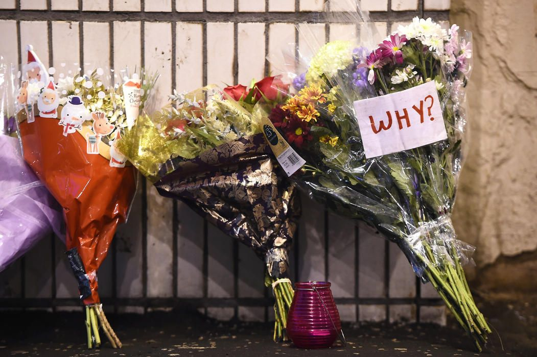 Floral tributes are placed near to the scene of yesterday's bin lorry crash on December 23, 2014 in Glasgow, Scotland. Six people were killed and eight injured after a bin lorry careered out of control in Queen Street in the city centre and ploughed into pedestrians out Christmas shopping