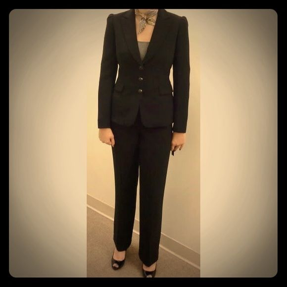 Black Tahari pantsuit Stylish, chic, and perfect for interviews. Worn a handful of times. No marks, tears, scuffs, or other defects that I could find. Matte fabric texture. Pants with two button closure and clasp. Blazer with 3 buttons and 2 pockets with flaps that can be tucked in or out. Size 2. Happy to answer questions. Make me an offer!  Tahari Other