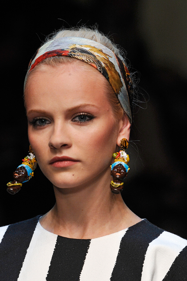 Dolce & Gabana need a kick in the crotch.  These severed heads dangling from a pale-skinned model's ear are not fun or playful, but simply evocative of some of the darkest times in Western history.