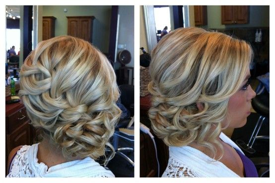 curled low updo.