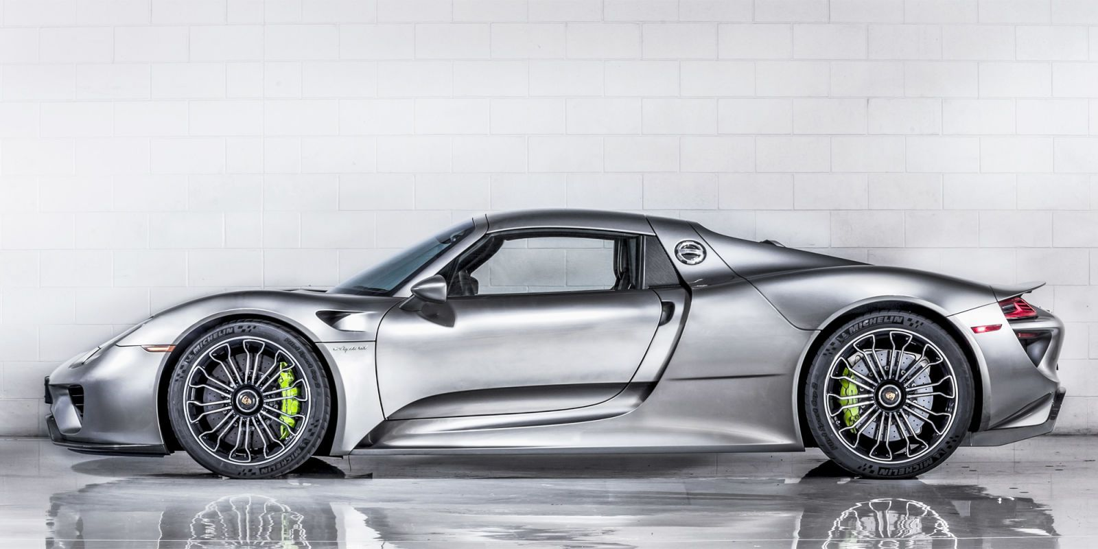 """PORSCHE 918 SPYDER """"The 918 is so different from any other Porsche being produced now. When you look at the details and their purpose and functionality, it's amazing how everything is blended. This is going to be a moment in Porsche's history that validates other thinking. It will motivate future design processes. The 918 will become an important car but also a timeless car.""""Photograph by Marc Urbano"""