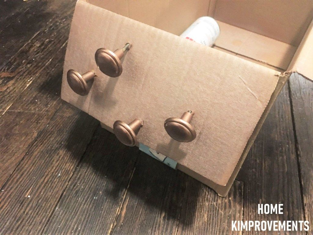 Use a cardboard box to attach your hardware. This will let you get to all parts of it without having to touch and move them with your hands! Check out my blog for more DIY tips, tricks and ideas!  #DIY #homeimprovement #furnitureflip #furnitureflipping #hardware #spraypaint #hack #diyhack #furniture #homekimprovements #furniturepainter #paint #easy #farmhouse #metal #metallicpaint #metallic