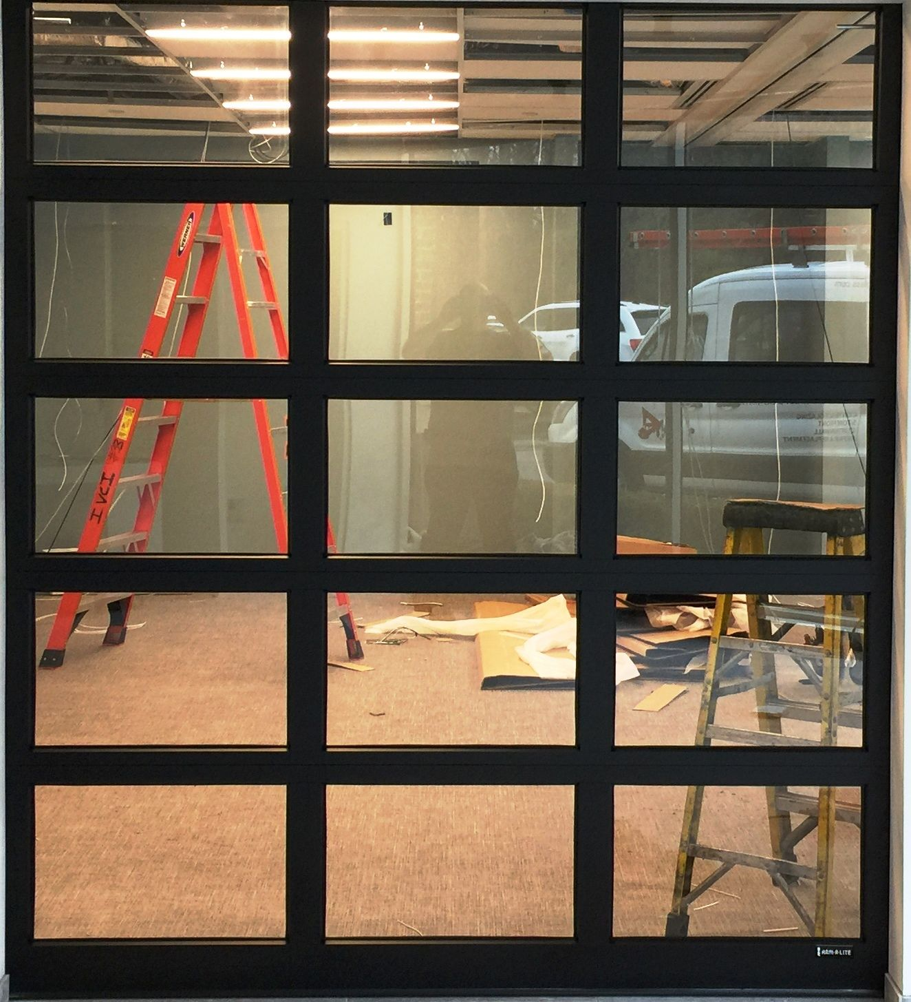 Black Frame Glass Garage Doors From Arm R Lite Come With An Unmatched 20 Year Welded Frame Warranty This Also Include Garage Doors Glass Garage Door New Homes