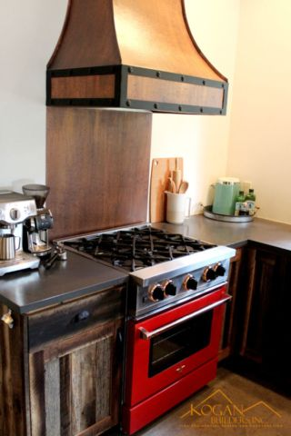 Lakeside Cabin Stove Detail With Custom Copper Range Hood And Red Gas Oven By Wolf Appliance Wood Kitchen Kitchen Design Cabin Style