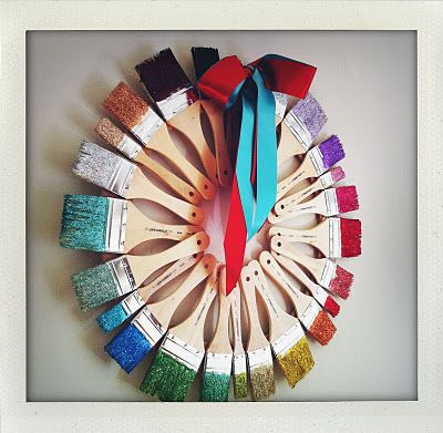 Color wheel wreath. This could be created easily with worn out paintbrushes OMG IM IN LOVE