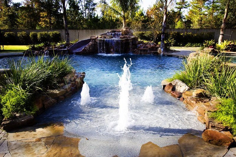 playful bubblers on a tropical beach entry pool with grotto waterfall