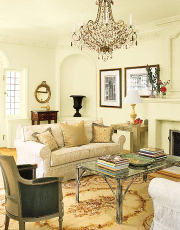 Old world charmer chandeliers living rooms and country living stately living room a creamy palette unites disparate elements including an aubusson rug a weathered metal coffee table and a vintage chandelier aloadofball Choice Image