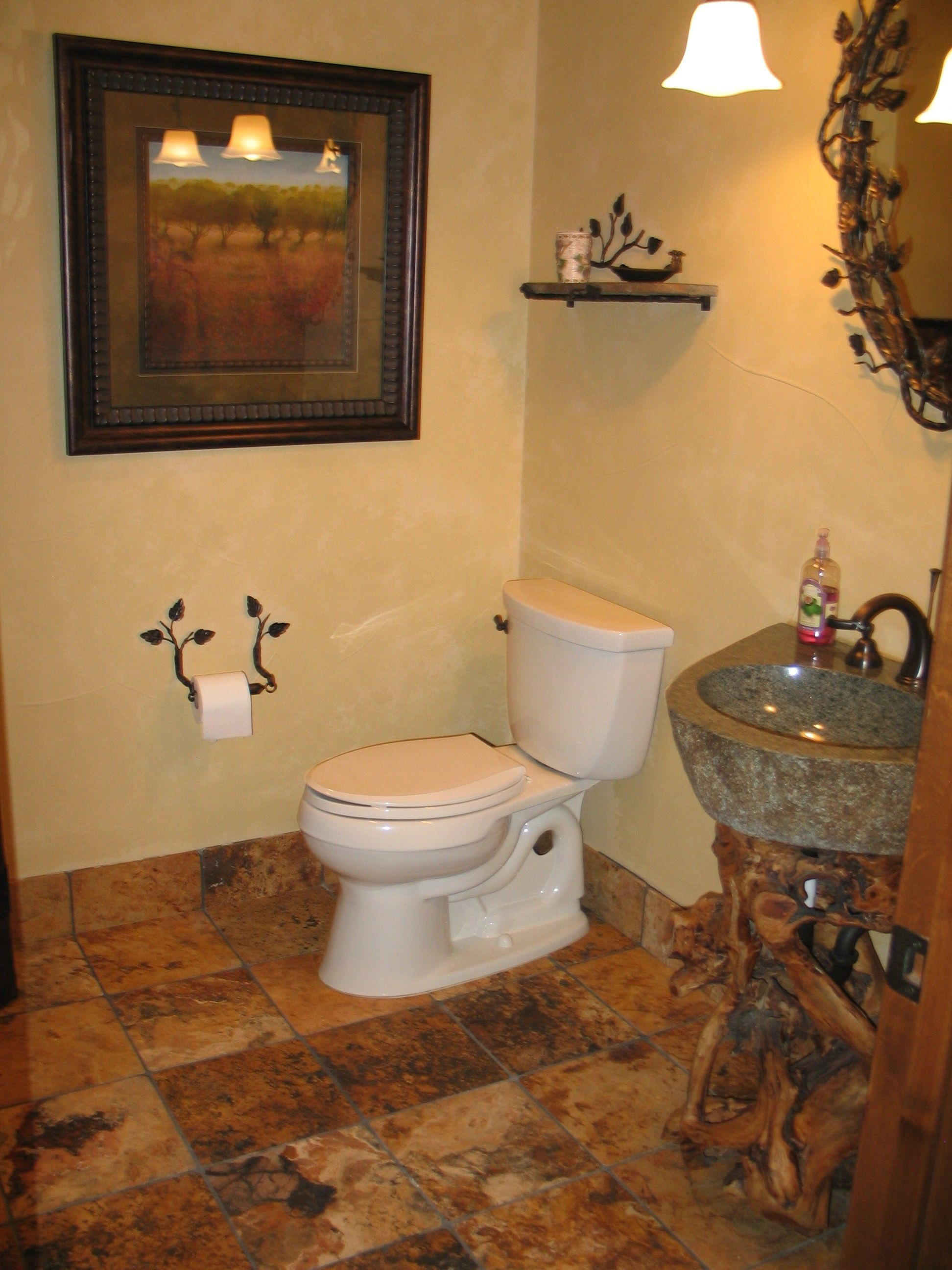 Cccc Bathroom Featuring Geode Floor Tiles And Tree Trunk With