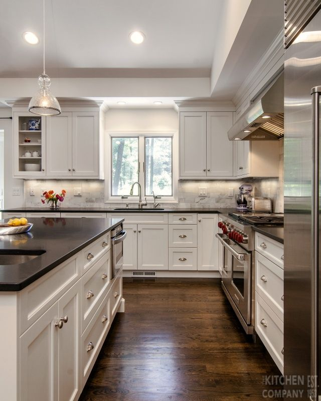 black and white kitchen cabinetry: woodmode brookhaven with nordic