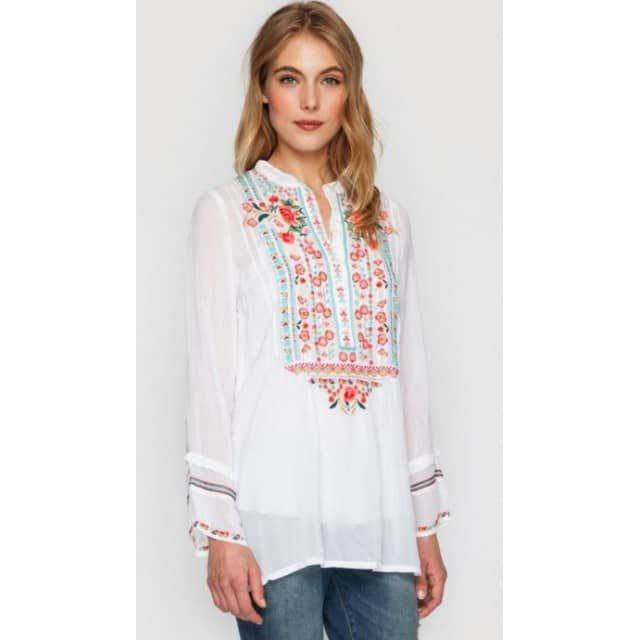"The Johnny Was Catra Tunic is a boho must-have! This tunic top features a colorful embroidery design detailing the henley front, accented by embroidered sleeve hems. Pair this embroidered tunic with a colorful cami and printed pants for the ultimate bohemian look! This long sleeve top has antiqued shell like buttons up the front, long enough to wear with pants or leggings! Made out of Rayon Georgette. Small is measuring approx. 40"" across the bust, meant to fit generous with a length of 28"""
