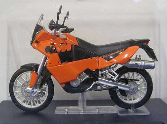 Ex Mag 1:24 KTM 950 Diecast Model Motorcycle FD21 This KTM 950 Rally LC8 Diecast Model Motorcycle is Orange and has working steering, wheels and also comes in a display case. It is made by Ex Mag and is 1:24 scale (approx. 8cm / 3.1in long). #ExMag #ModelMotorbike #KTM