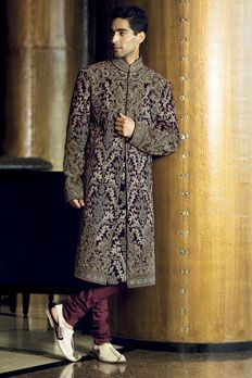 Velvet sherwani with all over resham work.