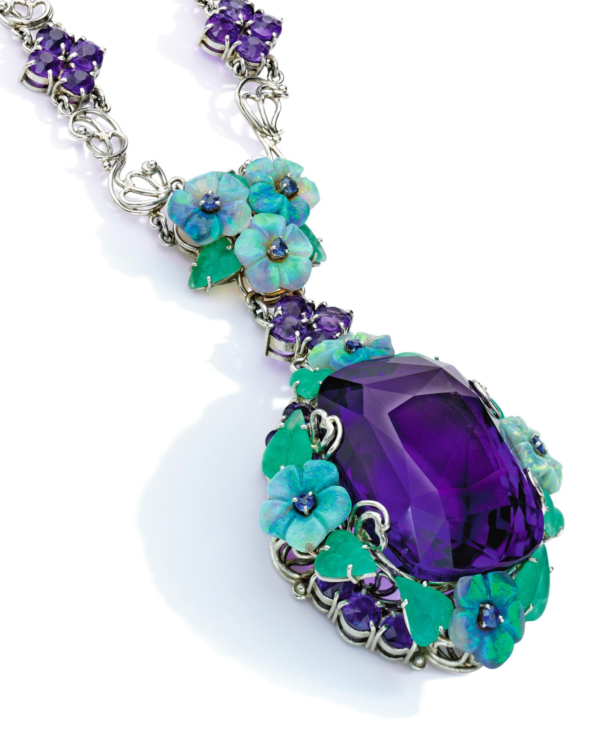 Louis Comfort Tiffany For Tiffany Co An Arts And Crafts Amethyst Opal Sapphire And Green Hardstone Pendant Necklace Circa 1920 Supporting A Penda Jewels