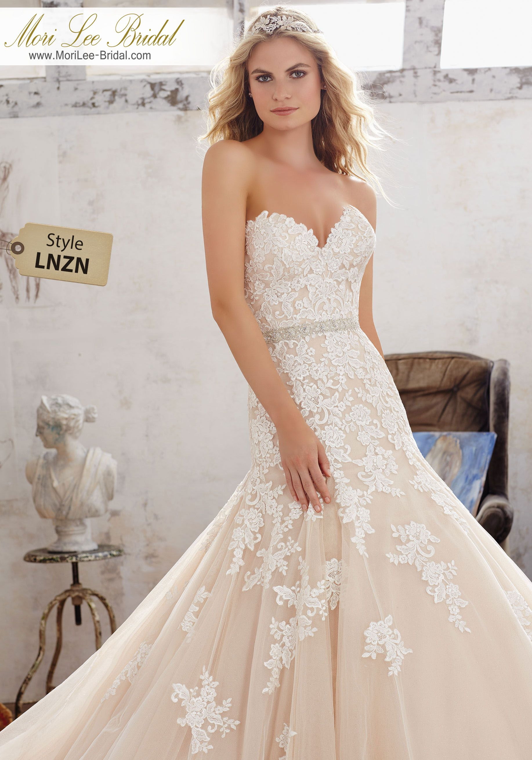 Style LNZN  Mackenzie Wedding Dress New 2017 Wedding Dress, it's a classic Fit & Flare Bridal Gown Featuring Sweetheart Neckline and Frosted, Embroidered AppliquŽes on Tulle Over Sparkle Net. Covered Button Detail Along Back. Removable Beaded Net Belt, Colors Available: White, Ivory, Ivory/Caramel. Shown in Ivory/Caramel.