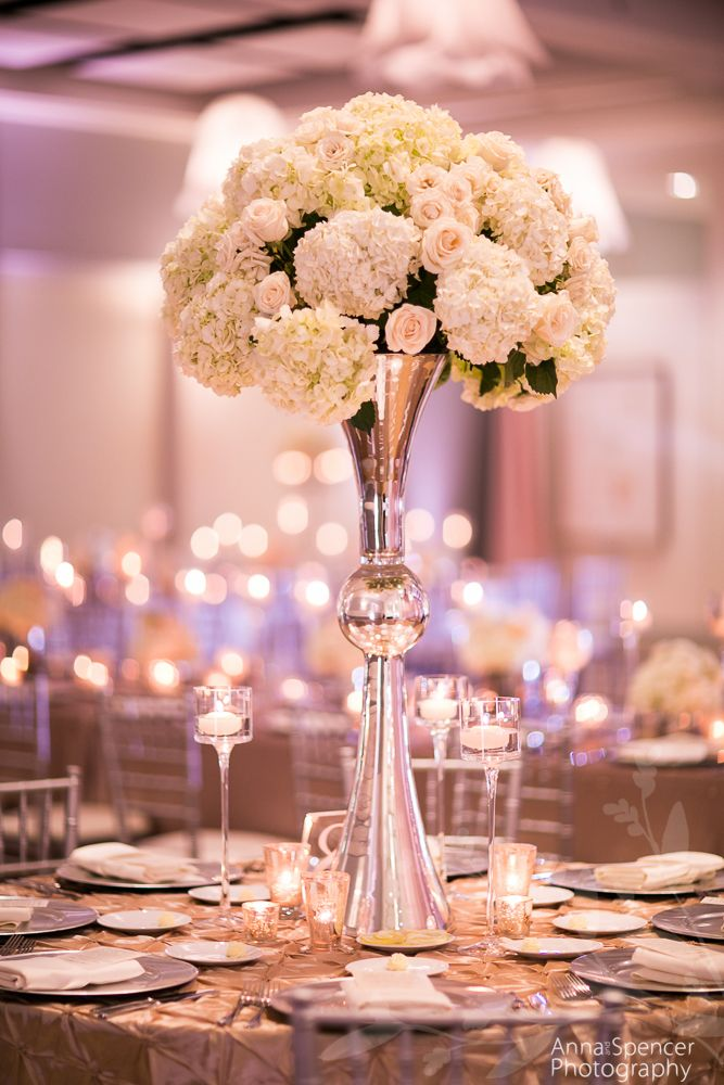 Tall white floral arrangement by Edge Design Group florist.