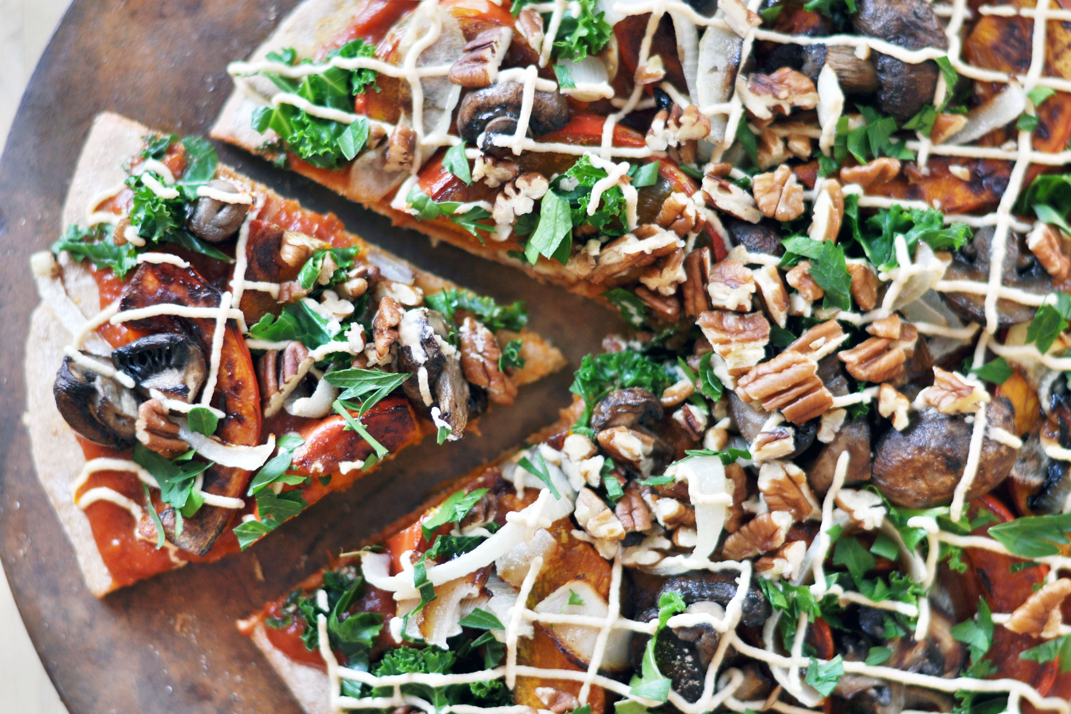 Vegan Harvest Pizza with Cashew Cheese- kabocha squash, kale, onions, mushrooms, pizza sauce, parsley, walnuts.