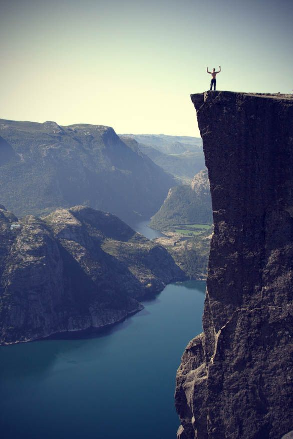 Man On Top Of The Cliff In Norway Fjord