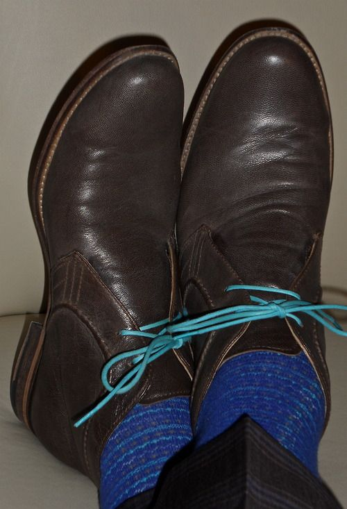 Hush Puppies w/ blue laces…