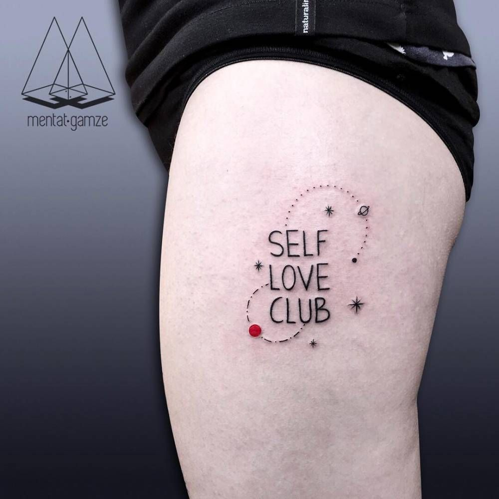 """Self Love Club"" tattoo on the left thigh"