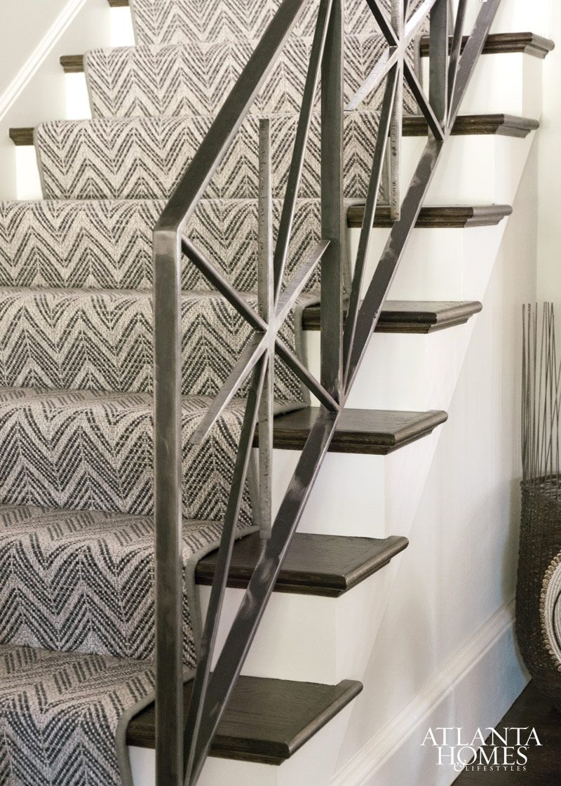 Masterful Mix For A Transitional Home   Dark Stair Treads, Neutral Chevron  Pattern Runner, Interesting Iron Railings