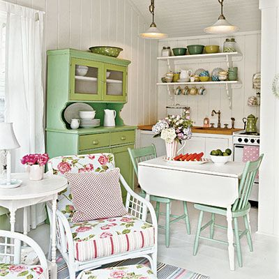 We're loving the vintage vibe in this kitchen from antique pieces and pastel colors.