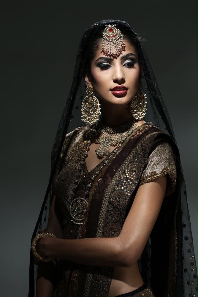 Large round maang tikka with large earrings and puff sleeves metallic blouse   Indian bridal ...