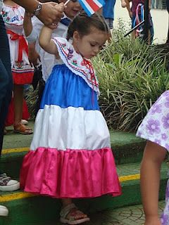 A girl dressed in a Costa Rican traditional dress.