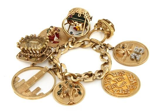 A 14 Karat Yellow Gold Charm Bracelet With Eight Attached Charms Consisting Of Two 18 And Citrine