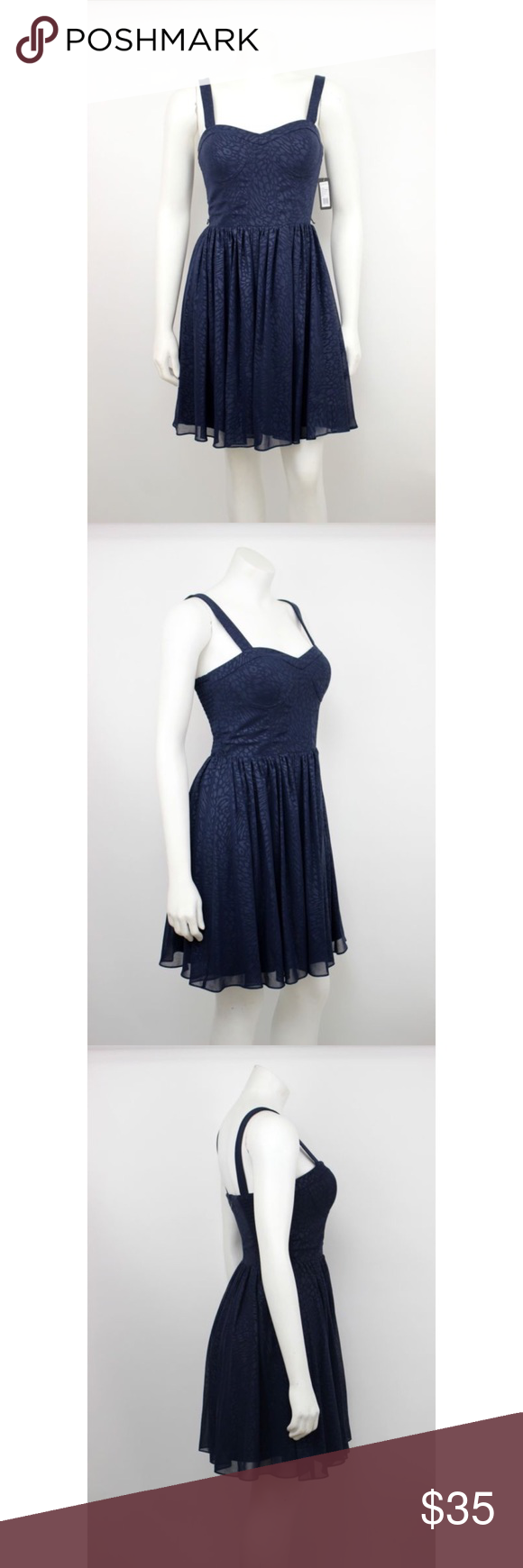 "NWT Guess Navy Blue Animal Print Chiffon Dress NWT Guess Navy Blue Corset Bodice Animal Print Overlay Chiffon Dress. Has belt loops for a belt.   Measurements (flat / un-stretched): Tagged Size: 4 Bust: 30"" Length (shoulder to hem): 34"" Guess Dresses"