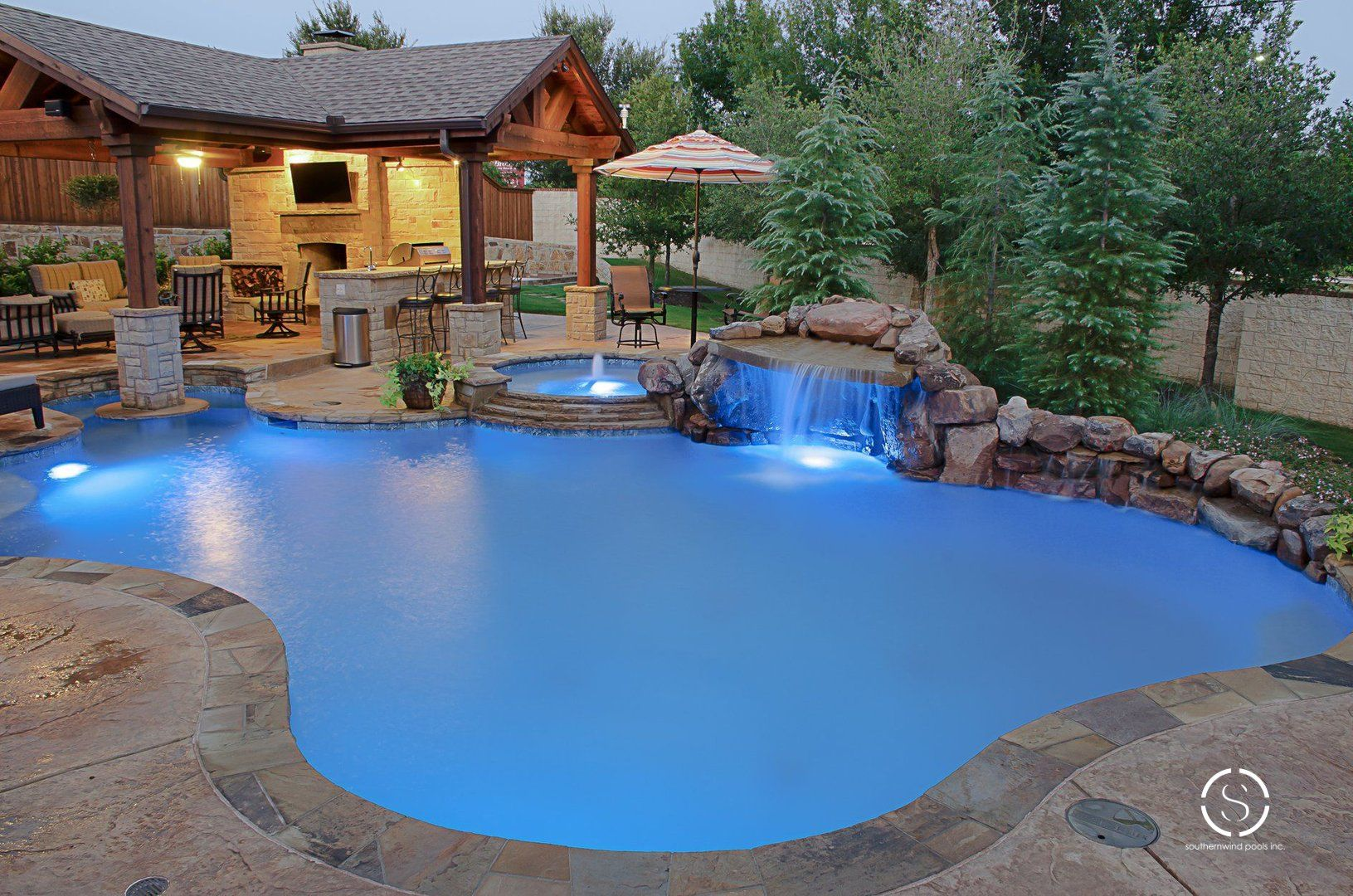 Natural freeform pool and spa with waterfall and ... |Small Freeform Pools With Waterfalls