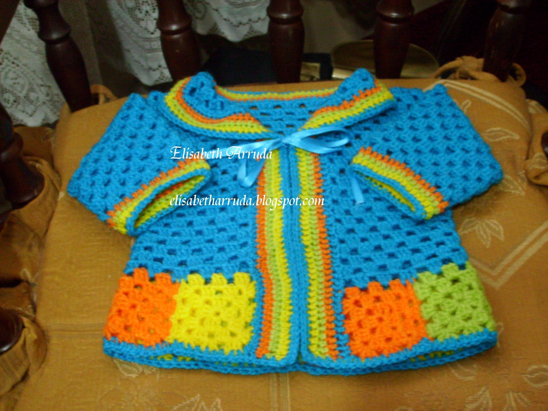 casaquinho em lã com barra formada por squares