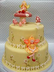 SO Pretty Fairy Cake  This was a vanilla cake with vanilla buttercream and strawberry jam filling covered in fondant....