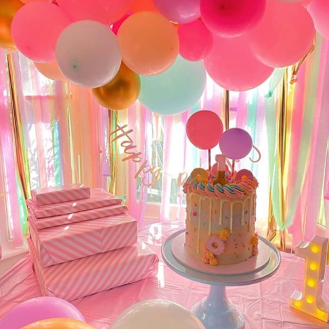 "Ginger Ray on Instagram: ""Such a beautiful and colourful first birthday set up! Our pastel balloon and streamer backdrop really is perfect for all ages � #pastel…"""