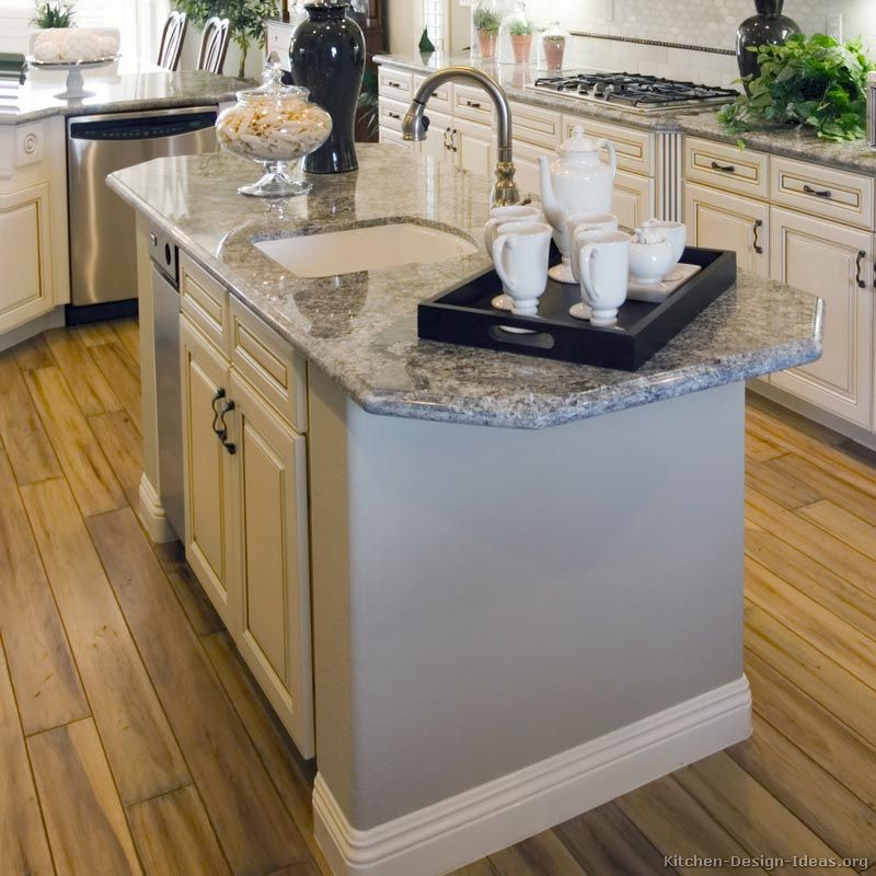 Antique White Kitchen With Wood Floors And An Island Sink Kitchen Island With Sink Kitchen Island Plans Modern Kitchen Island