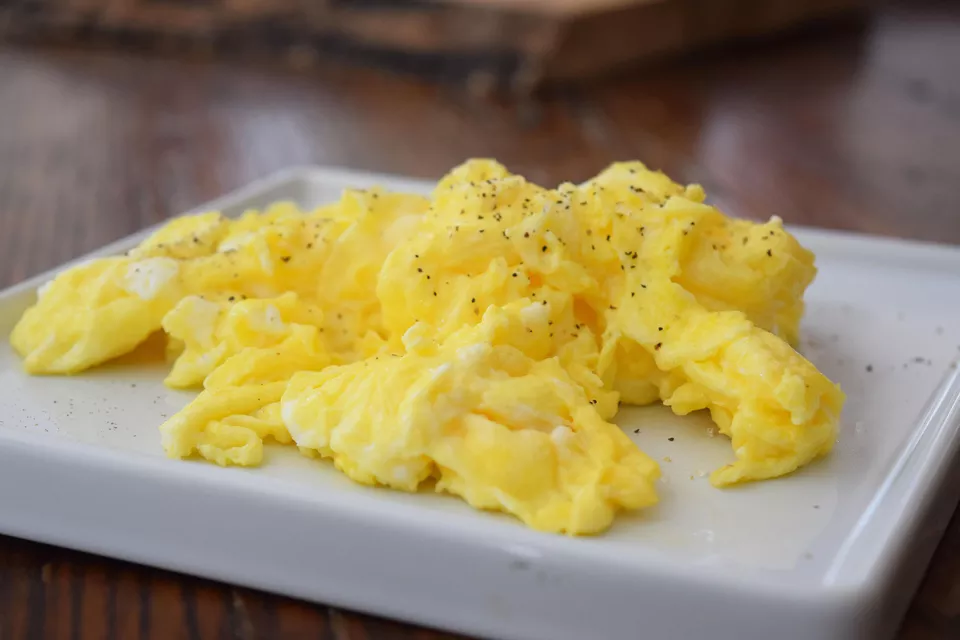 Learn To Make Perfect Buttery Scrambled Eggs Recipe Scrambled Eggs Recipe Fluffy Scrambled Eggs Egg Recipes For Breakfast