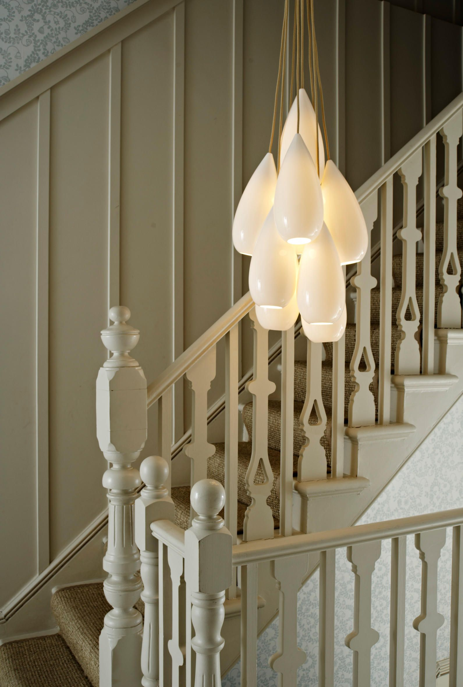 A Chandelier Gives Lovely Atmospheric Warmth Providing Relaxed Feel To Any Room Here An Original BTC Drop Zero Hangs Above Staircase