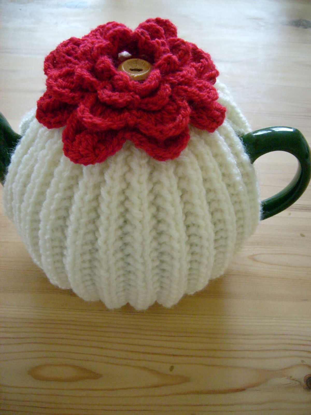 Hand knitted tea cosy with deep red crochet flower to warm a hand knitted tea cosy with deep red crochet flower to warm a med t pot bankloansurffo Images